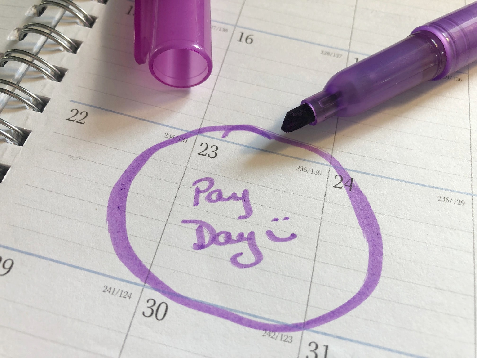 Calendar date circled in purple with the words pay day written