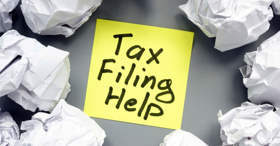 Yellow sticky note with words Tax Filing Help