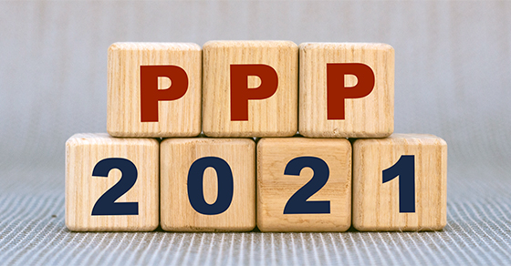wooden blocks spelling ppp and 2021